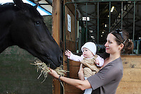 6/8/2010. Julie Ficher and daughter Isabelle aged 6 months from Kildare are pictured with their horse Jack at the Failte Ireland RDS House Show. Picture James Horan/Collins