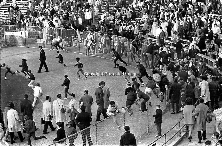 Kezar Statium 1967, fans swarm the field after San Francisco 49ers game with the Baltimore Colts ended.<br />(photo 1967/Ron Riesterer)