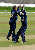 One Day International, Scotland V Canada, at Mannofield, Aberdeen - Scots spinner Ross Lyons celebrates the first stumping in International cricket with young Arbroath wicketkeeper Marc Petrie, who removed the bailes of Canadian capt Ashish Bagai off his bowling - Picture by Donald MacLeod 08.07.09