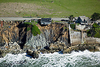aerial photograph of costal erosion and a house ready to fall into the Pacific Ocean along Highway One in Sonoma County, California