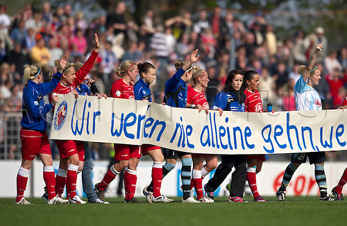 17 04 2011   After the Game The Players from Potsdam show a banner stating We will Never be alone as We stand together  UEFA Women Champions League Season 2010 2011 Semi-finals  Turbine Potsdam versus FCR Duisburg in Potsdam