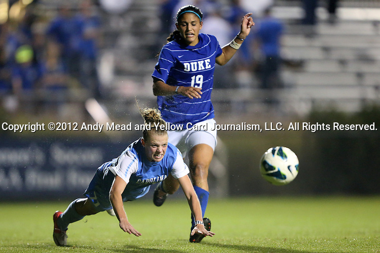 18 October 2012: UNC's Hanna Gardner (71) heads the ball away from Duke's Kim DeCesare (19). The University of North Carolina Tar Heels defeated the Duke University Blue Devils 2-0 at Koskinen Stadium in Durham, North Carolina in a 2012 NCAA Division I Women's Soccer game.