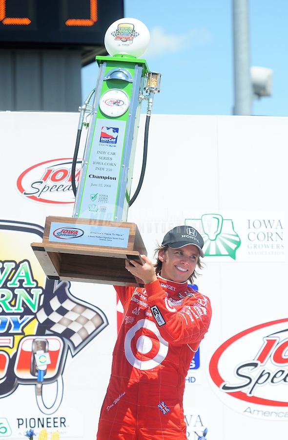Jun. 22, 2008; Newton, IA, USA; IRL driver Dan Wheldon celebrates after winning the Iowa Corn Indy 250 at the Iowa Speedway. Mandatory Credit: Mark J. Rebilas-