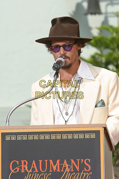 JOHNNY DEPP.Honored with a Hand and Footprint Ceremony at Graumann's Chinese Theatre, Hollywood,.Los Angeles, 16th September 2005.half length brown hat cream suit sunglasses speech.Ref: ADM/JW.www.capitalpictures.com.sales@capitalpictures.com.© Capital Pictures.