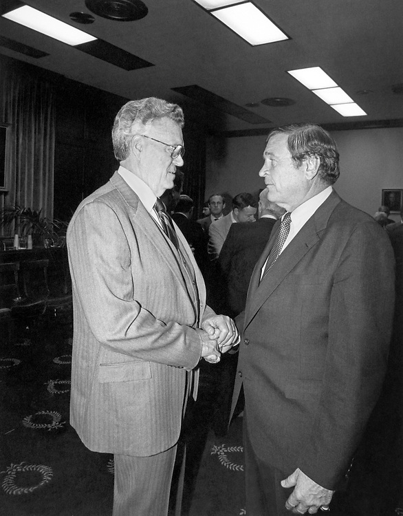 """Rep. Daniel David """"Dan"""" Rostenkowski, D-Ill., Chairman of the Ways and Means Committee shaking hands with political leader. (Photo by CQ Roll Call)"""