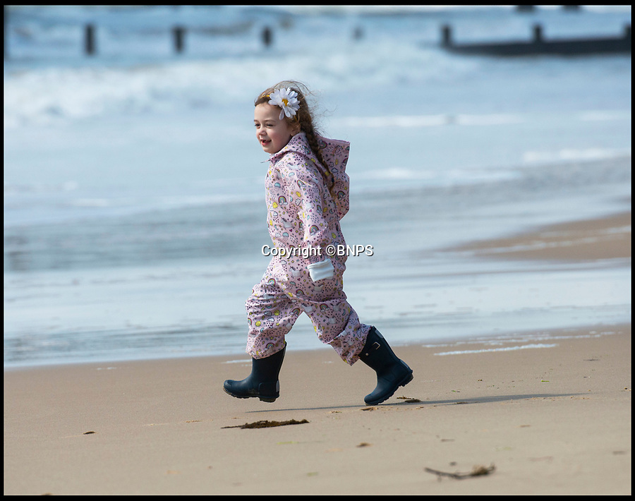 BNPS.co.uk (01202 558833)<br /> Pic: PhilYeomans/BNPS<br /> <br /> Nikita Annal's (6) first taste of summer...<br /> <br /> Spring has finally arrived on Bournemouth beach today...and it looks like it could be here to stay.