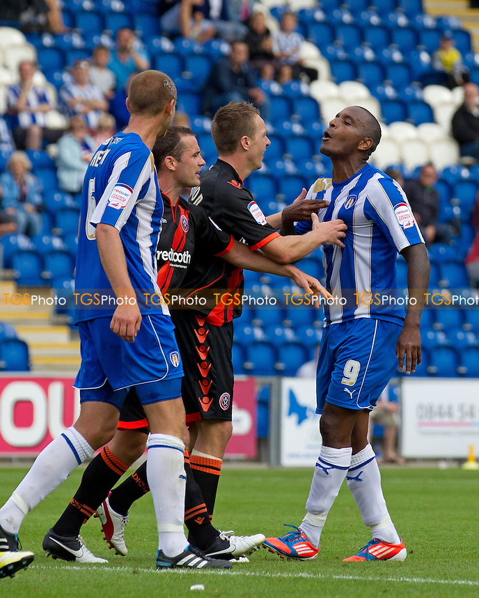 Events get a little tense as Tony McMahon, Sheffield United FC calms down Clinton Morrison, Colchester United FC - Colchester United vs Sheffield United - NPower League One Football at the Weston Homes Community Stadium, Colchester, Essex - 25/08/12 - MANDATORY CREDIT: Ray Lawrence/TGSPHOTO - Self billing applies where appropriate - 0845 094 6026 - contact@tgsphoto.co.uk - NO UNPAID USE.