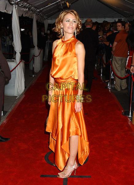 "REBECCA DAVIS.2005 Toronto Film Festival - ""Where The Truth Lies"" Premiere held at Roy thomson Hall, Toronto, Ontario..September 13th, 2005 .Photo Credit: Laura Farr/AdMedia/Capital Pictures.full length orange silk satin dress sleeveless.www.capitalpictures.com.sales@capitalpictures.com.© Capital Pictures."