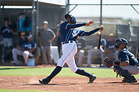 San Diego Padres right fielder Cristian Heredia (44) follows through on his swing in front of catcher Luis Avalo (97) during an Instructional League game against the Milwaukee Brewers at Peoria Sports Complex on September 21, 2018 in Peoria, Arizona. (Zachary Lucy/Four Seam Images)