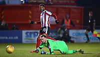 Lincoln City's Matt Green puts the ball past Notts County's Ross Fitzsimons to score his sides second goal<br /> <br /> Photographer Chris Vaughan/CameraSport<br /> <br /> The EFL Sky Bet League Two - Lincoln City v Notts County - Saturday 13th January 2018 - Sincil Bank - Lincoln<br /> <br /> World Copyright &copy; 2018 CameraSport. All rights reserved. 43 Linden Ave. Countesthorpe. Leicester. England. LE8 5PG - Tel: +44 (0) 116 277 4147 - admin@camerasport.com - www.camerasport.com