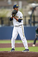 Michigan Wolverines pitcher Isaiah Paige (25) looks to his catcher for the sign in the NCAA baseball game against the Michigan State Spartans on May 7, 2019 at Ray Fisher Stadium in Ann Arbor, Michigan. Michigan defeated Michigan State 7-0. (Andrew Woolley/Four Seam Images)