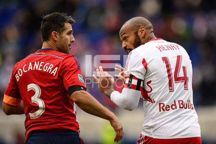 Thierry Henry (14) of the New York Red Bulls talks with Carlos Bocanegra (3) of Chivas USA. The New York Red Bulls and Chivas USA played to a 1-1 tie during a Major League Soccer (MLS) match at Red Bull Arena in Harrison, NJ, on March 30, 2014.