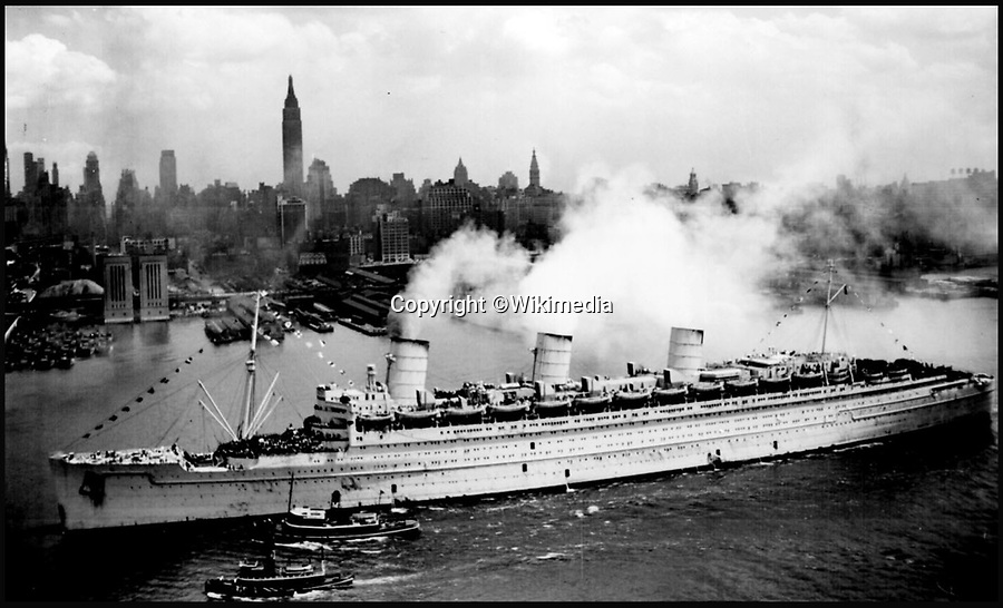 BNPS.co.uk (01202 558833)<br /> Pic CharlesMiller/BNPS<br /> <br /> The Queen Mary arriving in New York during the war - the flag would have flown from the front mast.<br /> <br /> One of the largest flags in the world, that once graced the bow of the Queen Mary during WW2, is being sold by auctioneer Charles Miller in London.<br /> <br /> At 36 feet by 17, the huge blue ensign is the size of a double decker bus, and was flown by the famous liner when she served as a troopship during the war.<br /> <br /> The Queen Mary held the prestigious Blue Riband for the fastest Atlantic crossing from 1936 to 1952, and now is run as a hotel in Long Beach, California.
