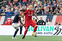FOXBOROUGH, MA - AUGUST 31: Michael Bradley #4 of Toronto FC controls the ball as Juan Agudelo #17 of New England Revolution pressures during a game between Toronto FC and New England Revolution at Gillette Stadium on August 31, 2019 in Foxborough, Massachusetts.