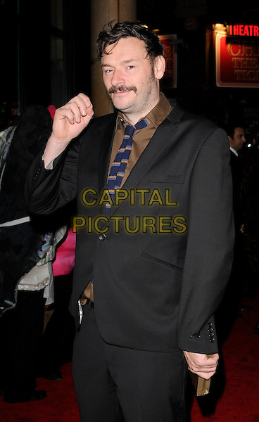 "JULIAN BARRETT .Attending ""The Bunny & The Bull"" Gala Screening during the Times BFI 53rd London Film Festival, Vue West End, Leicester Square, London, England, 23rd October 2009..half length moustache mustache brown shirt suit tie blue striped facial hair hand .CAP/CAN.©Can Nguyen/Capital Pictures"