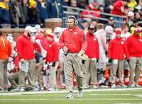 Ohio State Buckeyes head coach Urban Meyer talks into his headset during their game against Michigan Wolverines at Michigan Stadium in Arbor, Michigan on November 28, 2015.  (Dispatch photo by Kyle Robertson)