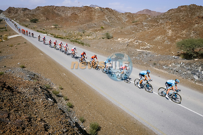 The peloton lined out during Stage 5 of the 10th Tour of Oman 2019, running 152km from Samayil to Jabal Al Akhdhar (Green Mountain), Oman. 20th February 2019.<br /> Picture: ASO/P. Ballet | Cyclefile<br /> All photos usage must carry mandatory copyright credit (© Cyclefile | ASO/P. Ballet)
