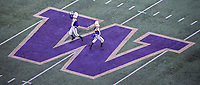 Drum majors perform during the Husky Band's pregame show.