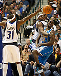 Dallas Mavericks' Brendan Haywood, center, knocks the ball from New Orleans Hornets' Emeka Okafor, right, as teammate Jason Terry reaches for it during an NBA basketball game at American Airlines Center in Dallas on February 28, 2010.   (Photo by Khampha Bouaphanh)