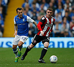 John Fleck of Sheffield Utd gets clear of Ross Wallace of Sheffield Wednesday during the Championship match at the Hillsborough Stadium, Sheffield. Picture date 24th September 2017. Picture credit should read: Simon Bellis/Sportimage