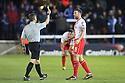 Jon Ashton of Stevenage is shown a yellow card by referee Michael Jones<br />  - Peterborough United v Stevenage - Sky Bet League One - London Road, Peterborough - 23rd November 2013. <br /> © Kevin Coleman 2013