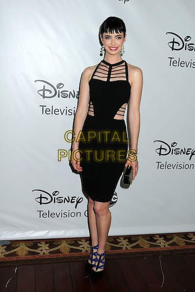 Krysten Ritter.Disney ABC 2012 TCA Winter Press Tour held at the Langham Huntington Hotel, Pasadena, California, USA..January 10th, 2012.full length black dress sleeveless strappy straps cut out away clutch bag shoes blue.CAP/ADM/BP.©Byron Purvis/AdMedia/Capital Pictures.