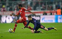 FUSSBALL  CHAMPIONS LEAGUE  ACHTELFINALE  HINSPIEL  2012/2013      FC Bayern Muenchen - FC Arsenal London     13.03.2013 David Alaba (li, FC Bayern Muenchen) gegen Aaron Ramsey (re, Arsenal)