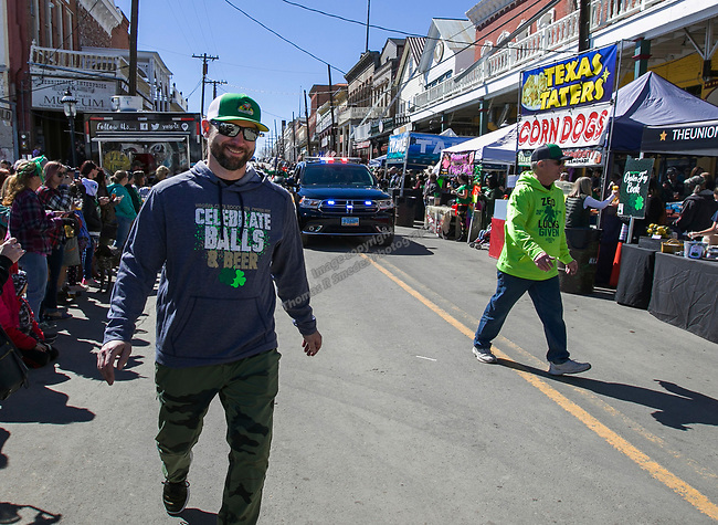 Promoter Jess Horning, left, walks the parade route before the start of the 28th annual Rocky Mountain Oyster Fry and St. Patrick's Day Parade in Virginia City, Nevada on Saturday March 16, 2019.