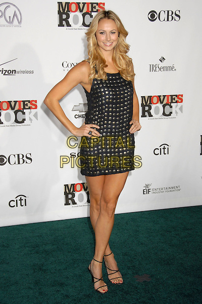 STACEY KEIBLER.2007 Movies Rock Celebration Presented by Conde Nast Media Group at the Kodak Theatre, Hollywood, California USA, 2 December 2007..full length black silver studded dress hand son hips stacy.CAP/ADM/BP.©Byron Purvis/AdMedia/Capital Pictures.