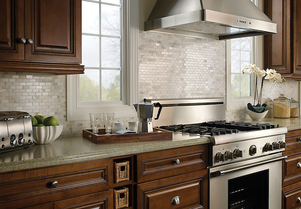 This custom kitchen features a handmade Running Bond 2x4 cm mosaic tile backsplash shown in polished Calacatta Tia from New Ravenna. <br />