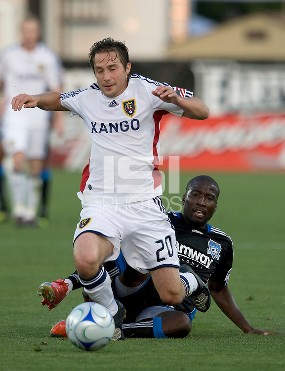 30 May 2009: Cornell Glen of the Earthquakes tries to tackle the ball away from Ned Grabavoy of the Real Salt Lake during the game at Buck Shaw Stadium in Santa Clara, California.   Earthquakes defeated Real Salt Lake, 2-1.