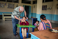 Father Laborde in a jolly mood with a resident child of Asha Neer a home for poor and disabled children on Andul Road in Howrah. West Bengal, India, Arindam Mukherjee/Agency Genesis