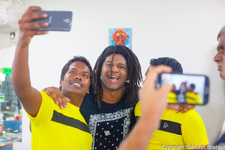 14 July 2016 - Pune - INDIA.<br /> Thrilled Barbers click photos with Jamal Idris in a Barber's Saloon at  Balewadi village at Pune.<br /> <br /> (Subhash Sharma for the Sunday Telegraph)