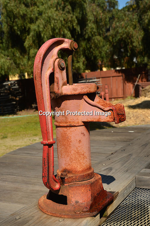 Stock photo of an old hand water pump