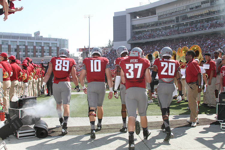 The captains, Travis Long, Jeff Tuel, Marquess Wilson, Jared Byers and Deone Bucannon, enter the field prior to the start of the Washington State home opening football game against Eastern Washington University at Martin Stadium in Pullman, Washington, on Saturday, September 8, 2012.  The Cougars prevailed over the Eagles in a hard fought game, 24-20.