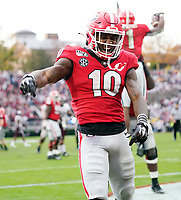 ATHENS, GA - NOVEMBER 23: Kearis Jackson #10 of the Georgia Bulldogs celebrates after a Georgia touchdown during a game between Texas A