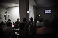 Pilgrims watching the final soccer match of Euro 2012 in the house of Mirjana Dragićević. <br />