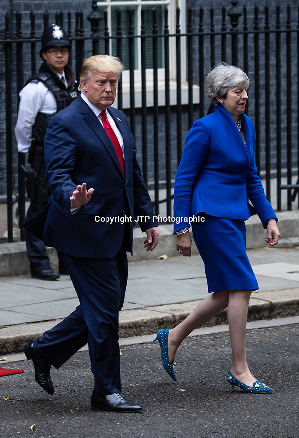 Prime Minister Theresa May greets US President Donald Trump, accompanied by First Lady Melania, to 10 Downing Street during the State Visit to Britain