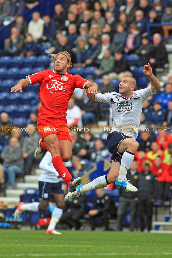 Alan Smith of MK Dons & Preston's Keith Keane in an aerial challenge - Preston North End vs MK Dons - NPower League One Football at Deepdale, Preston, Lancashire - 14/10/12 - MANDATORY CREDIT: Paul Dennis/TGSPHOTO - Self billing applies where appropriate - 0845 094 6026 - contact@tgsphoto.co.uk - NO UNPAID USE.