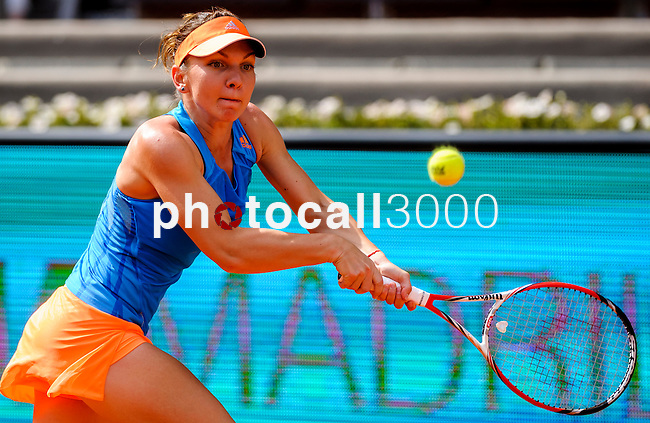 "Romanian tennis player Simona Halep returns a ball to Russian tennis player Maria Sharapova during their women's singles final tennis match of the Madrid Masters at the ""Caja Magica"" sports complex in Madrid on May 11, 2014.<br /> <br /> Photocall3000/Daniel Calleja"