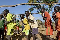 ETHIOPIA Province Benishangul-Gumuz, town Debate, Gumuz village Banush, Gumuz boys play pipe and dance / AETHIOPIEN, Provinz Benishangul-Gumuz, Stadt Debate, Gumuz Dorf Banush, Gumuz floeten Pfeifen und tanzen