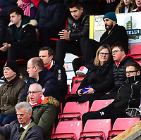 Lincoln City fans watch their team in action<br /> <br /> Photographer Andrew Vaughan/CameraSport<br /> <br /> The EFL Sky Bet League Two - Swindon Town v Lincoln City - Saturday 12th January 2019 - County Ground - Swindon<br /> <br /> World Copyright &copy; 2019 CameraSport. All rights reserved. 43 Linden Ave. Countesthorpe. Leicester. England. LE8 5PG - Tel: +44 (0) 116 277 4147 - admin@camerasport.com - www.camerasport.com