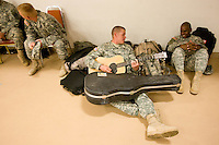 deployment0724 159900-- Specialist Joshua Moore, of Gilbert, plays his guitar as Sgt. Ethan Jones listens before they deployed Thursday with the Phoenix-based 3666th Support Maintenance Company. The Arizona troops will head to Camp Atterbury, Ind., for 30-45 days of training and.then travel to Iraq.   (Pat Shannahan/ The Arizona Republic)