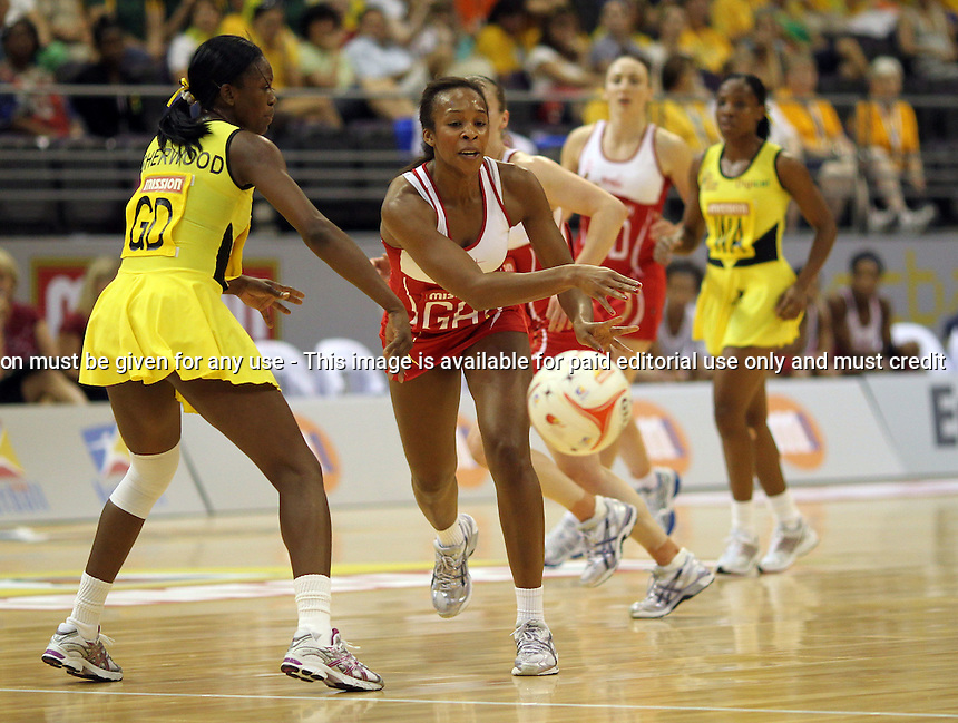 10.07.2011 England's Pamela Cookey in action during the netball match between the England and Jamaica at the Mission Foods World Netball Championship 2011 held at the Singapore Indoor Stadium in Singapore . Mandatory Photo Credit ©Michael Bradley.