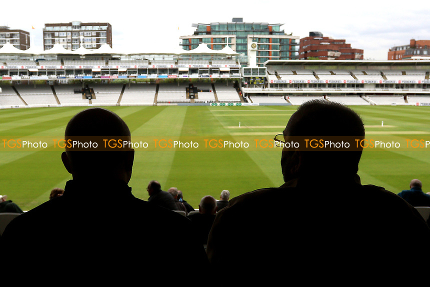 Spectators wait for the players to return as bad light delays play during Middlesex CCC vs Essex CCC, Specsavers County Championship Division 1 Cricket at Lord's Cricket Ground on 21st April 2017
