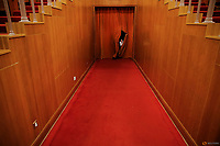 A man passes through a curtain covering the entrance of a main hall inside the Great Hall of the People where sessions of the National People's Congress (NPC) and the Chinese People's Political Consultative Conference (CPPCC) are taking place, in Beijing, China March 9, 2016.   REUTERS/Damir Sagolj