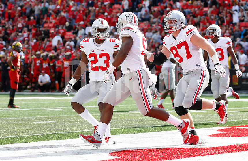 Ohio State Buckeyes safety Tyvis Powell (23) and defensive lineman Joey Bosa (97) congratulate linebacker Raekwon McMillan (5) on an interception for a touchdown during the fourth quarter of the NCAA football game against the Maryland Terrapins at Byrd Stadium in College Park, Maryland on Oct. 4, 2014. (Adam Cairns / The Columbus Dispatch)