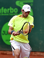 BOGOTA - COLOMBIA -09 -11-2013: Guilherme Clezar, tenista de Brasil devuelve la bola a Victor Estrella, tenista de Republica Dominicana, durante partido de semifinales del Seguros Bolivar Open en el Club Campestre el Rancho de la ciudad de Bogota. / Guilherme Clezar, Brazil tennis player returns the ball to Victor Estrella, Republica Dominicana tennis player during a match for the semifinals of the Seguros Bolivar Open in the Club Campestre El Rancho in Bogota city. Photo: VizzorImage  / Luis Ramirez / Staff.