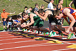 Runners leave the starting blocks in the 100 hurdles.