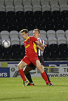 Scott Gray shields the ball from Graeme McGregor in the St Mirren v Dunfermline Athletic Clydesdale Bank Scottish Premier League U20 match played at St Mirren Park, Paisley on 2.10.12..